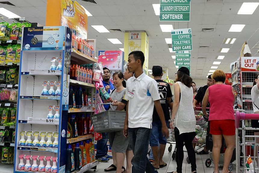Shoppers at the Aeon Bukit Indah Shopping Centre in Johor Bahru on March 31, 2015, a day before the Goods and Services Tax kicked in on April 1. Malaysia's economy grew 5.6 per cent in the first quarter of the year, faster than expected largely due t