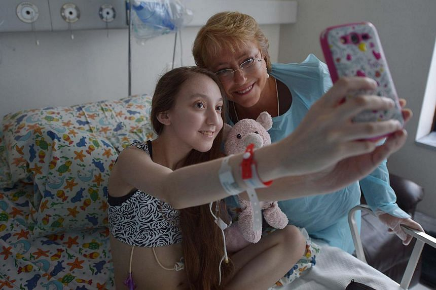 President Michele Bachelet poses for a selfie with Chilean teen Valentina Maureira on Feb 28, 2015. -- PHOTO: AFP