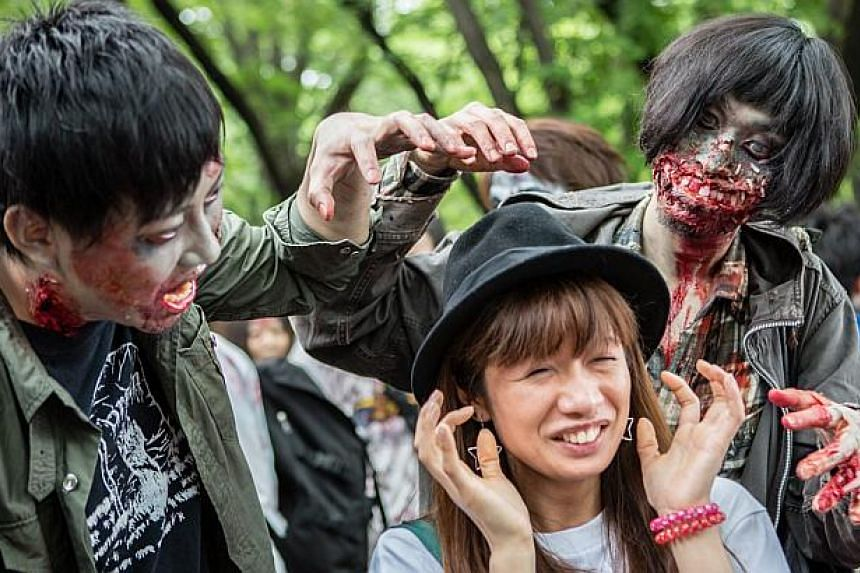 Participants have fun as they take part in a zombie walk in Tokyo, Japan on May 16, 2015. -- PHOTO: EPA
