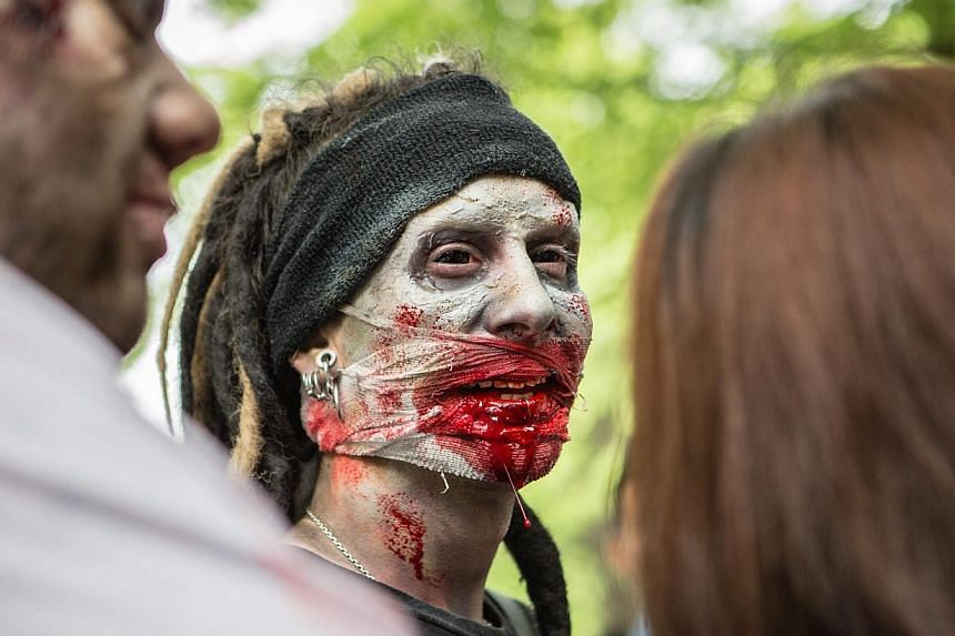 A participant takes part in a zombie walk in Tokyo, Japan on May 16, 2015. -- PHOTO: EPA