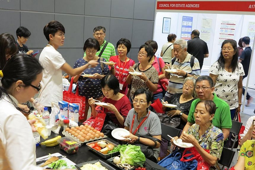 Tasting time during a crepe-making workshop at the 50plus Expo at Suntec Convention and Exhibition Centre on Saturday May 16, 2015.-- ST PHOTO: YEO SAM JO