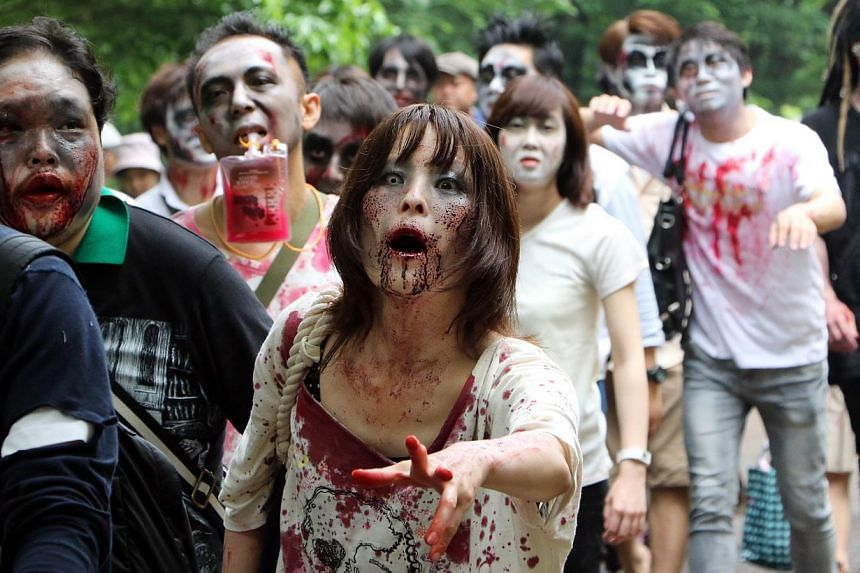 Participants take part in a 'zombie walk' at a park in Tokyo on May 16, 2015. -- PHOTO: AFP