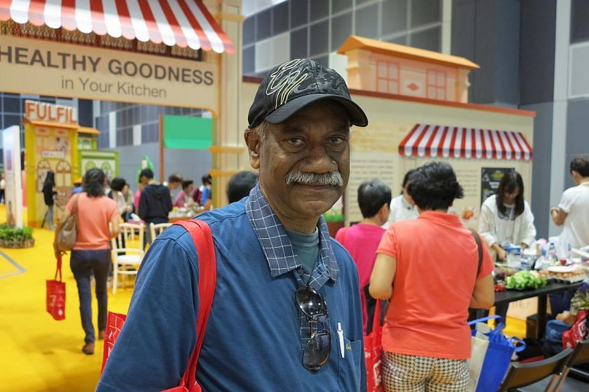 Mr Yoganathan Ratnasabapathy, 68, a retired engineer, at the 50plus Expo at Suntec Convention and Exhibition Centre on Saturday, May 16, 2015. Mr Yoganathan said he is keen to sign up for IT courses.-- ST PHOTO: YEO SAM JO