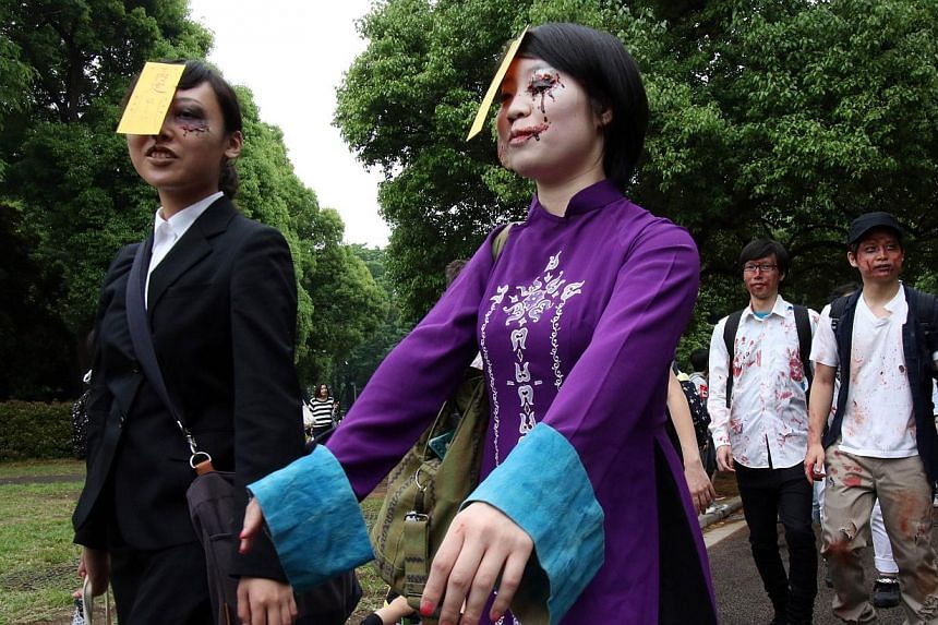 Participants take part in a 'zombie walk' at a park in Tokyo on May 16, 2015.-- PHOTO: AFP
