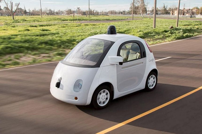 A Google self-driving car on March 15, 2015. Google will begin testing self-driving cars of its own design on public roads this summer, but they will have steering wheels and brakes, which is not what the company described a year ago. -- PHOTO: REUTE