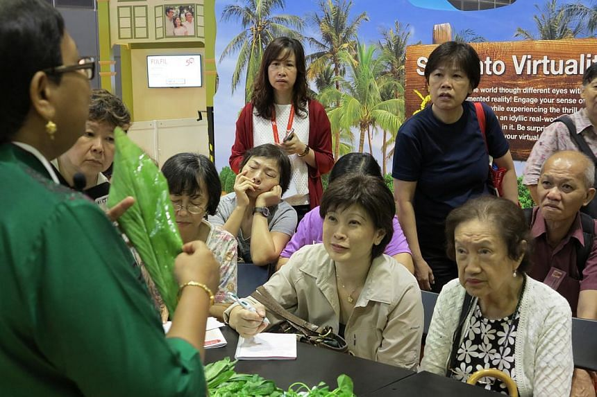 Seniors attending a workshop on herbs at the 50plus Expo event at Suntec Convention and Exhibition Centre on Saturday, May 16, 2015.-- ST PHOTO: YEO SAM JO