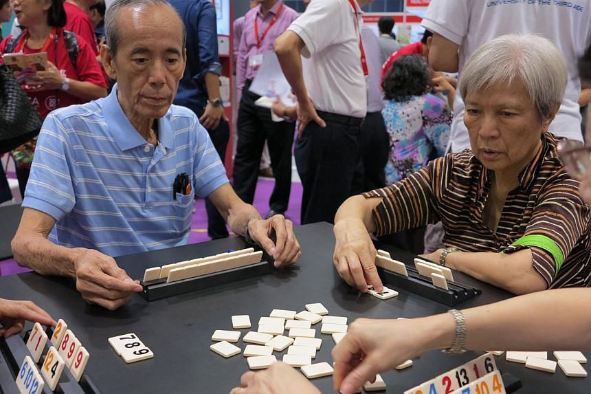 Seniors playing a game at the 50plus Expo event at Suntec Convention and Exhibition Centre on Saturday, May 16, 2015.-- ST PHOTO: YEO SAM JO