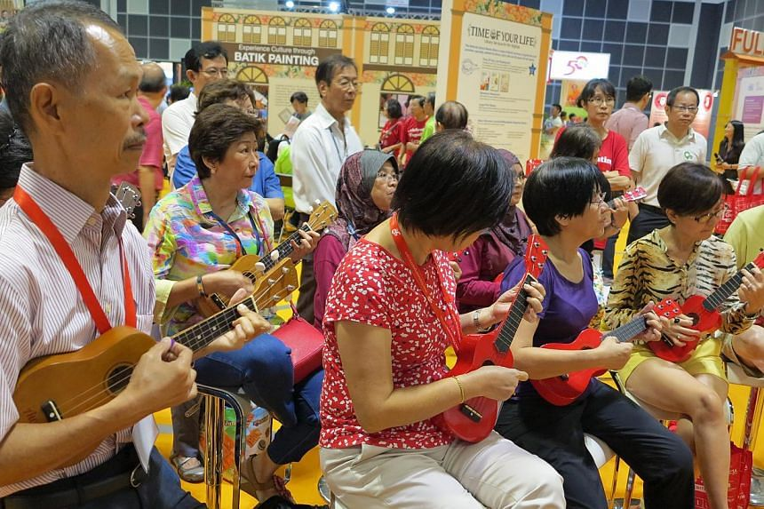 A ukulele workshop in progress at the 50plus Expo event at Suntec Convention and Exhibition Centre on Saturday, May 16, 2015.-- ST PHOTO: YEO SAM JO