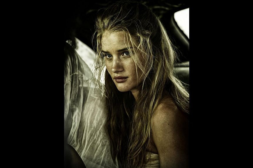 Rosie Huntington-Whiteley (above) and models playing the tyrant's wives Abbey Lee and Courtney Eaton, with American actress Zoe Kravitz in Mad Max: Fury Road. -- PHOTO: GOLDEN VILLAGE