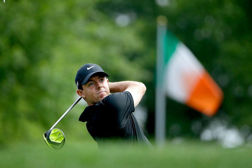 Rory McIlroy of Northern Ireland tees off on the first hole during round two at the Wells Fargo Championship at Quail Hollow Club on May 15, 2015, in Charlotte, North Carolina. -- PHOTO: AFP