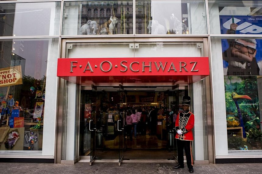 A doorman dressed as a toy soldier standing outside the FAO Schwarz flagship store on Fifth Avenue in New York, US. -- PHOTO: BLOOMBERG NEWS