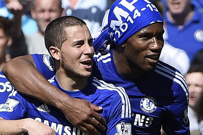 Chelsea's Eden Hazard (left) and Didier Drogba (right) celebrate after a match against Crystal Palace at Stamford Bridge, London, Britain, May 3, 2015. -- PHOTO: EPA