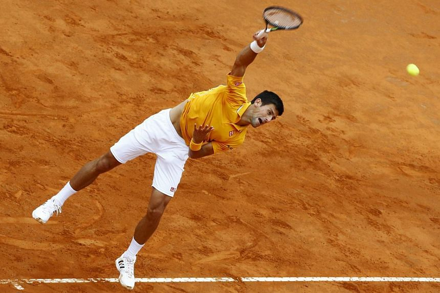 Novak Djokovic of Serbia serves to Kei Nishikori of Japan during their match at the Italian Open tennis tournament in Rome, Italy, May 15, 2015. -- PHOTO: REUTERS
