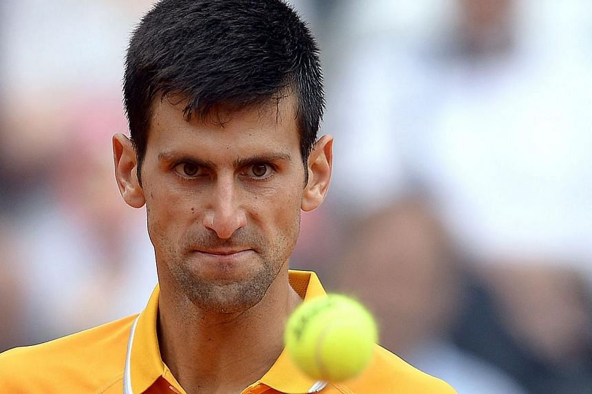 Novak Djokovic of Serbia eyes the ball during the semi final match against David Ferrer of Spain at the Italian Open on May 16, 2015, in Rome. -- PHOTO: AFP
