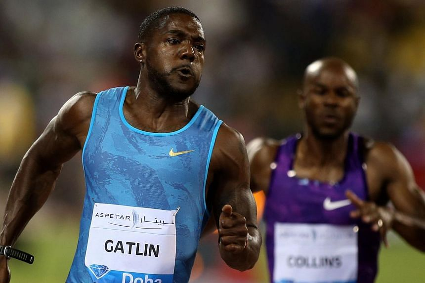 Justin Gatlin (left) of the United States sprints to win the 100m men's race at the Diamond League athletics meeting at the Suhaim bin Hamad Stadium in Doha on May 15, 2015. Gatlin set a world best time for 2015 at a Diamond meeting when he stormed t