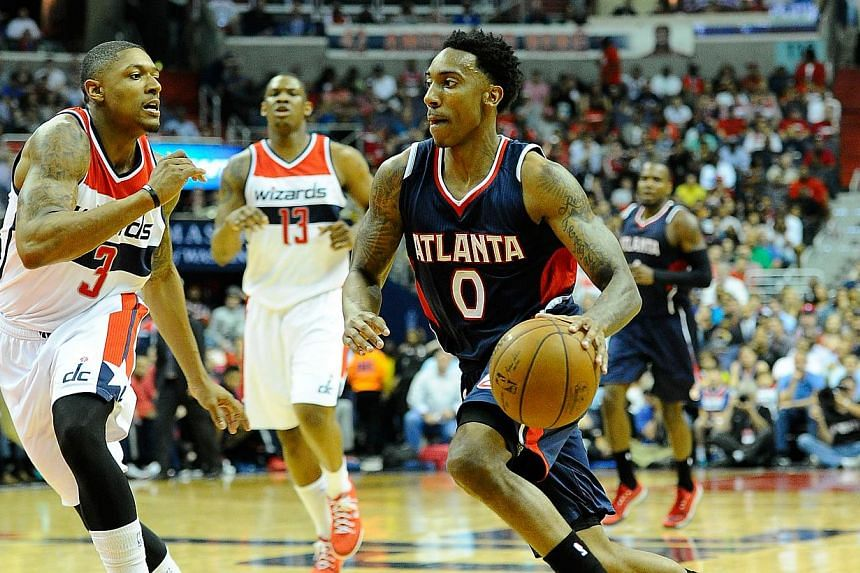 Atlanta Hawks guard Jeff Teague (right) dribbles past Washington Wizards guard Bradley Beal (left) during the first half in game six of the second round of the NBA Playoffs at Verizon Center. -- PHOTO: USA TODAY SPORTS