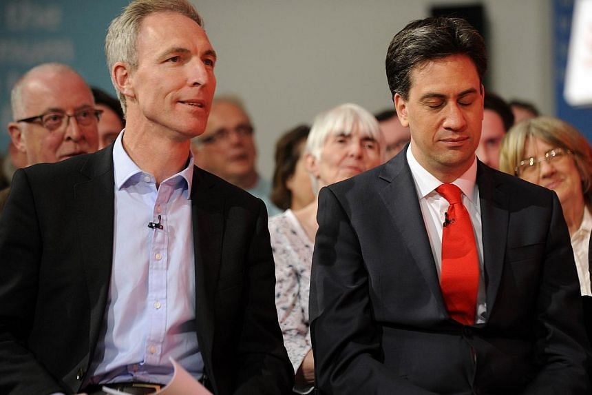 Scottish Labour Party leader Jim Murphy (left) sits with opposition Labour Party leader Ed Miliband (right) at a Labour Party general election campaign rally in Glasgow, Scotland, on May 1, 2015. -- PHOTO: AFP