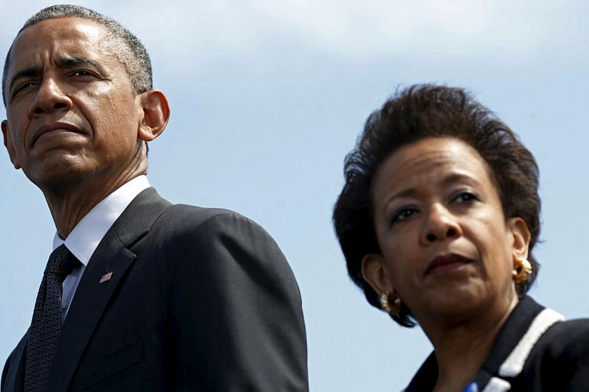 US President Barack Obama and US Attorney-General Loretta Lynch attend the 34th annual National Peace Officers' Memorial Service at the US Capitol in Washington on May 15, 2015. -- PHOTO: REUTERS