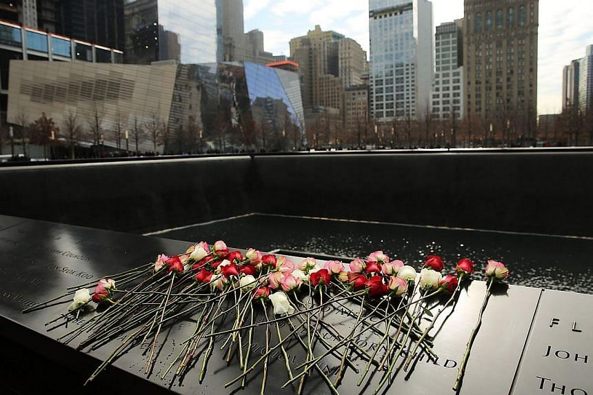 Flowers are viewed at one of the reflecting pools at Ground Zero with the names of those killed in the 1993 World Trade Center bombing that killed six people and injured more than 1,000, on February 26, 2015 in New York City. About 2.7 million people