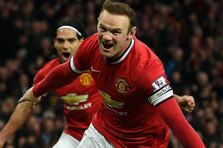 Manchester United's Wayne Rooney celebrates scoring a penalty during a match against Sunderland on Feb 28, 2015.Manchester United captain Rooney and left back Luke Shaw will miss the Premier League game against Arsenal on Sunday due to injury.