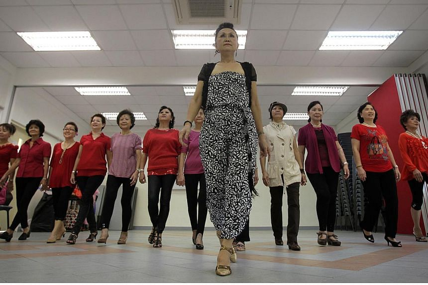 Senior citizens taking part in modelling and catwalk classes at the Toa Payoh East Community Club in 2011. Those aged 50 and above will get to enjoy over 400 educational courses for free this year, as part of Singapore's jubilee celebrations. -- PHOT