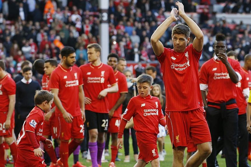 Liverpool's Steven Gerrard acknowledges the crowd as he walks on the pitch after his final game at Anfield. -- PHOTO: REUTERS