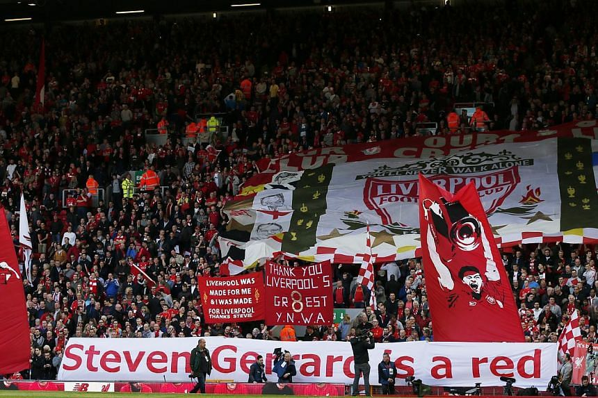 Liverpool fans with banners for Steven Gerrard before the match. -- PHOTO: REUTERS
