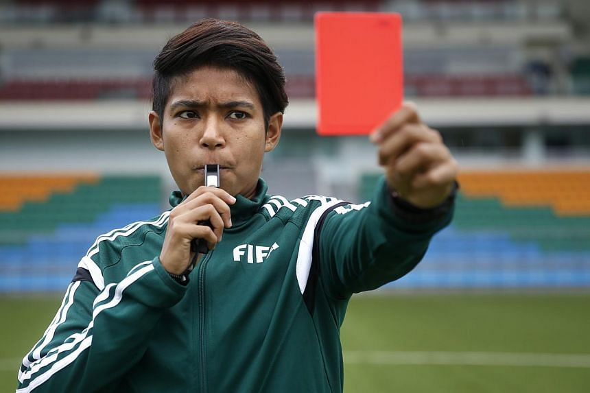 Singaporean football referee Abirami Naidu will complete a unique treble when she takes up the whistle at next month's Women's World Cup in Canada, having already officiated in the Women's World Cup at the Under-17 level in Costa Rica last year and t