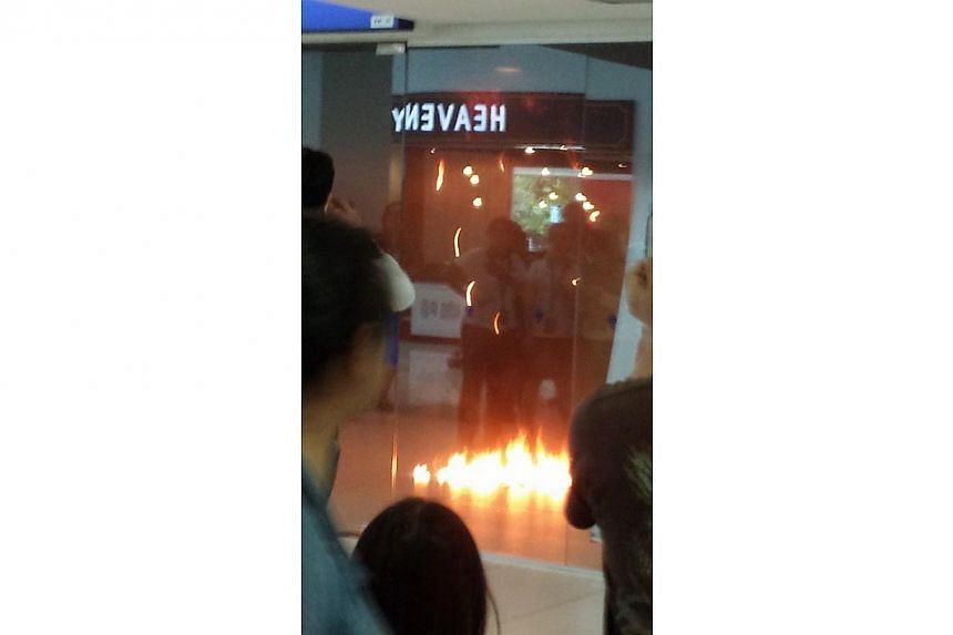A POSB branch in Rivervale Plaza in Sengkang caught fire on Sunday afternoon.-- PHOTO: STOMP