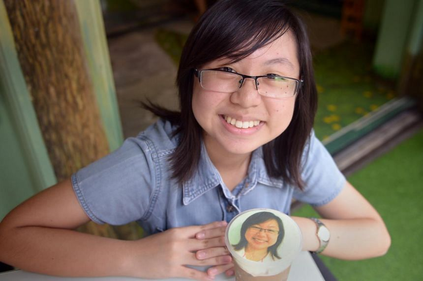 SundayLife! reporter Samantha Goh (above) gets her photo printed on her coffee. -- ST PHOTO: DANIEL NEO