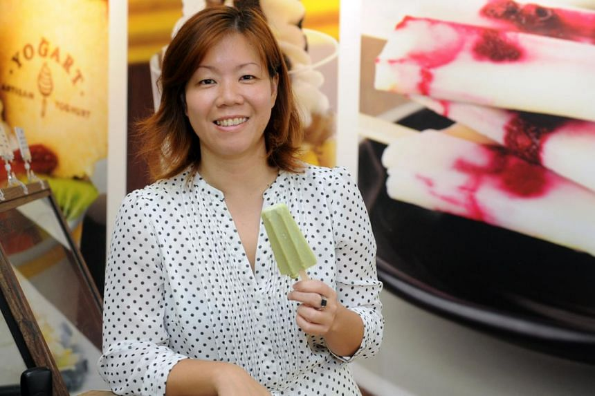 Yogart co-owner Lee Hwai Chi with the Holy Molli, a popsicle made from avocado and lime-flavoured frozen yogurt. -- ST PHOTO: TIFFANY GOH
