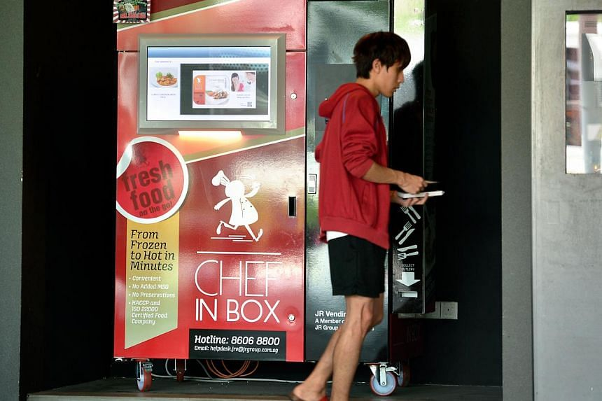 JR Vending has 70 Chef In Box machines (above) in places like hospitals and schools. Food options (top right) include curry chicken and hor fun. They are heated in a microwave for three minutes and dispensed with cutlery (right).