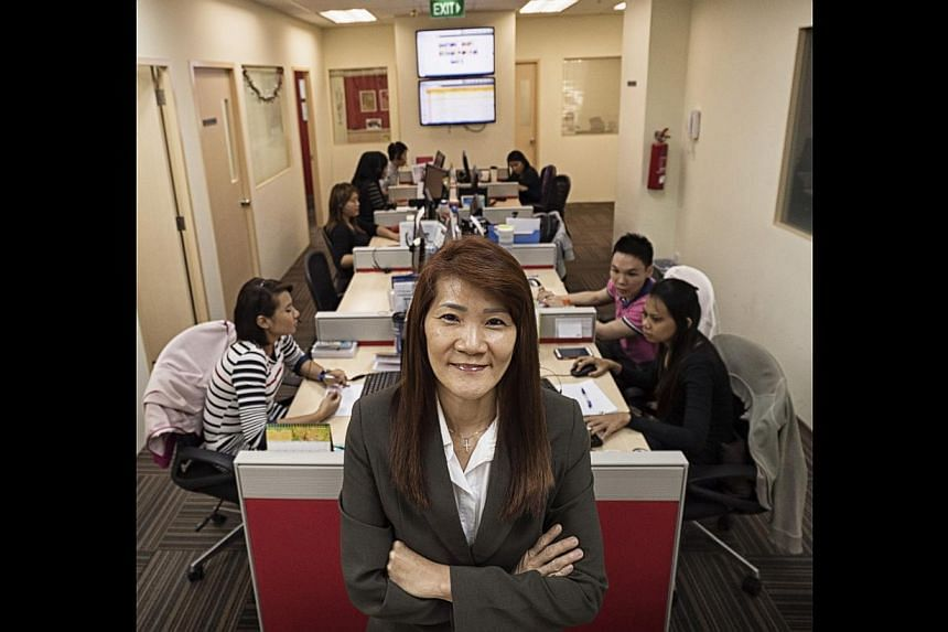 Ms Angel Ng oversees more than 50 employees, many of them ex-offenders, at Connect Centre. It trains former inmates to run its three call centres so they have a chance at holding down steady jobs and re-integrating into society.