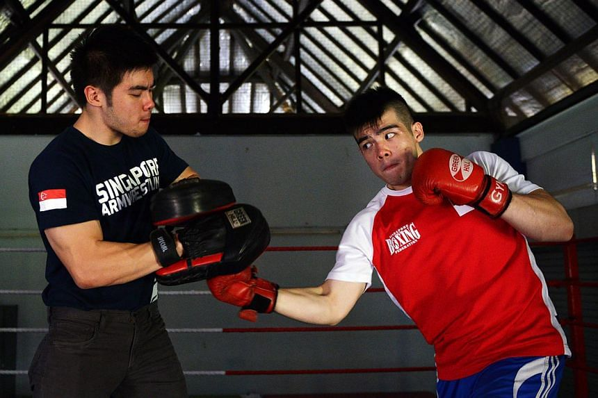 Tay Jia Wei (right), practising with his biggest supporter - his twin brother Jia Jun - took up boxing in a bid to stand up to bullies who teased him over his weight of 80kg when he was 14.