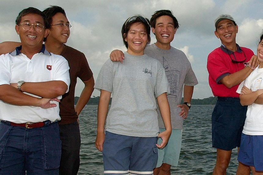 From left: Khor Chek Leong and son Teck Lin; Tan Wenqi and brother Wearn Haw, children of the late Yeok Keong; and Wong Ming Chee and daughter Maye-E have kept the love of sailing across generations. -- PHOTO: ST FILE
