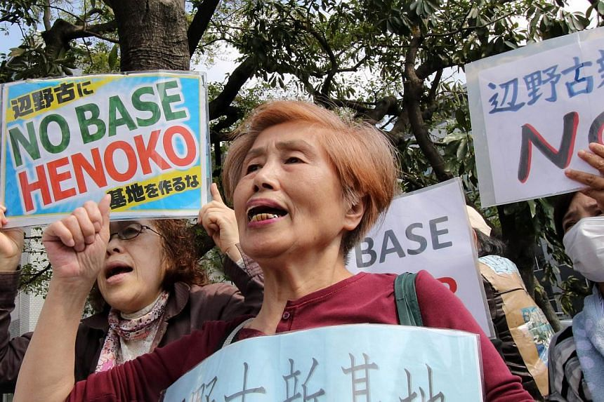 Activists shout slogans during a rally in front of the prime minister's official residence in Tokyo on April 17, 2015. Thousands of people rallied in Okinawa in southern Japan on Sunday in protest against a controversial United States airbase on the