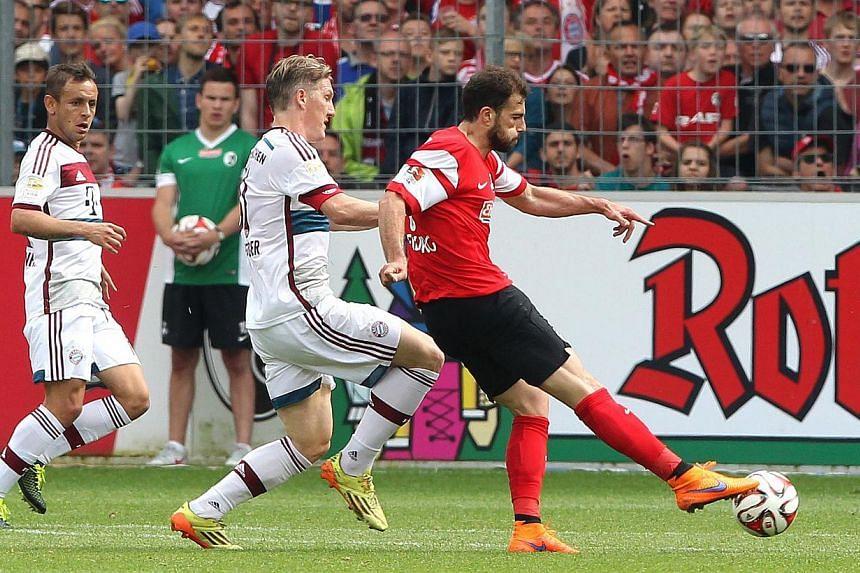 Freiburg's Swiss forward Admir Mehmedi (right) scores against Bayern Munich ion May 16, 2015. -- PHOTO: AFP
