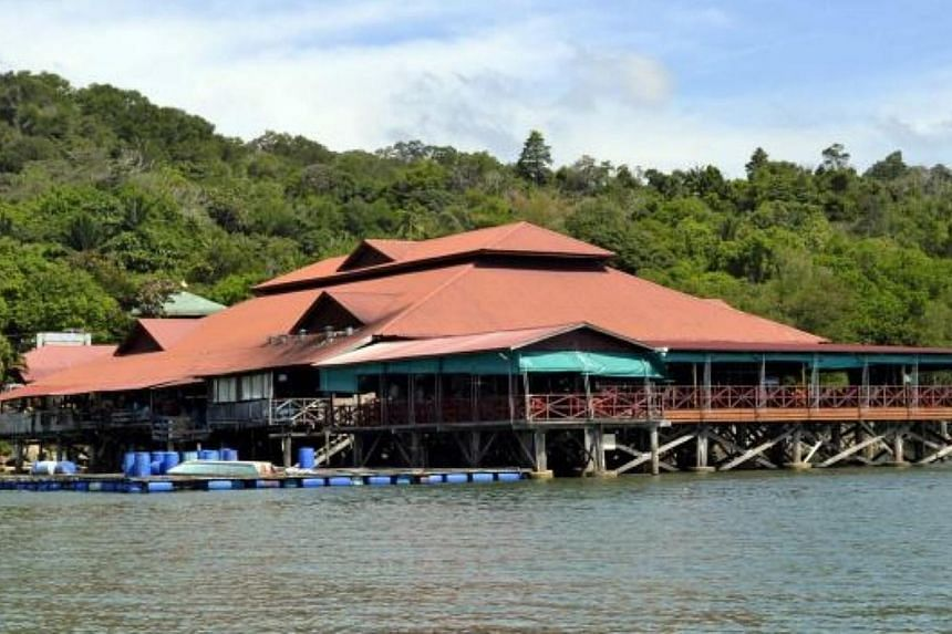 """Gunmen believed to be holding two Malaysians, who were kidnapped from the Ocean King seafood restaurant (pictured) just outsideSandakan town in Sabah,have contacted the victims' families with demands for a """"large"""" ransom, said police. --"""