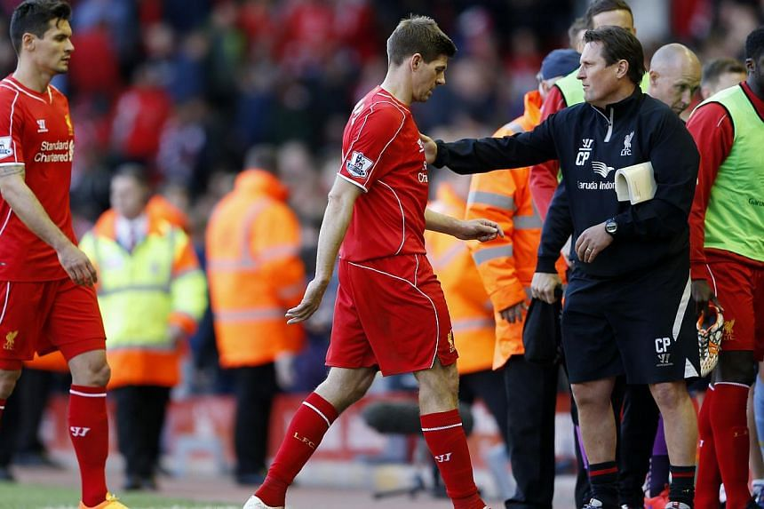 Liverpool's Steven Gerrard with assistant manager Colin Pascoe as he comes off after the first half.Long-serving Liverpool captain Steven Gerrard bade an underwhelming farewell to Anfield on Saturday as his side lost 3-1 to Crystal Palace in hi