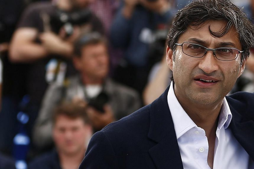 British director Asif Kapadia poses during the photocall for Amy at the 68th annual Cannes Film Festival on May 16, 2015. -- PHOTO: EPA