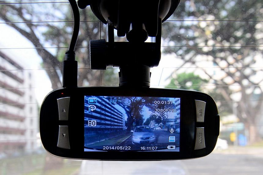 A community initiative called Vehicles on Watch helps to put drivers of cars with in-vehicle cameras in partnership with the police, to help raise neighbourhood safety. -- ST FILE PHOTO