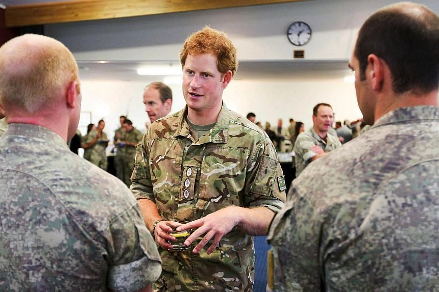 Britain's Prince Harry speaks to military personnel during his visit to Linton Military Camp near Palmerston North, on May 13, 2015.The British Royal called for the return of national service in his home country, crediting a military career for
