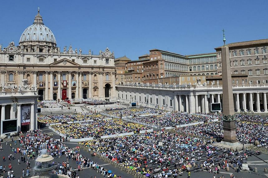 A general view shows the crowd in front St Peter's basilica during a Holy mass for the canonisation of four blessed nuns, two of whom lived in Ottoman Palestine, on May 17, 2015 in Vatican. -- PHOTO: AFP