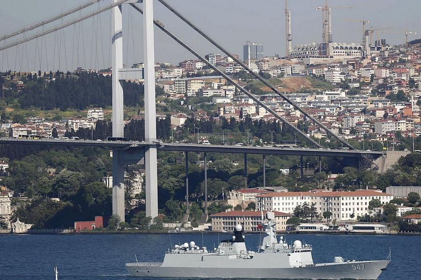 Chinese People's Liberation Army (PLA) navy frigate Linyi sets sail in the Bosphorus, on its way to the Mediterranean Sea, in Istanbul, Turkey on May 14, 2015. Nine Russian and Chinese navy vessels gathered in the Mediterranean Sea for joint military