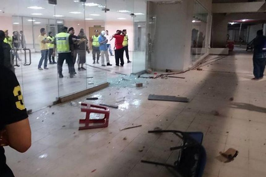 LionsXII players and their fans from Singapore were stranded at the Sultan Mizan Zainal Abidin stadium in Malaysia for about five hours, after Terengganu fans turned violent over their team's failure to qualify on Saturday for the Malaysian FA Cup fi