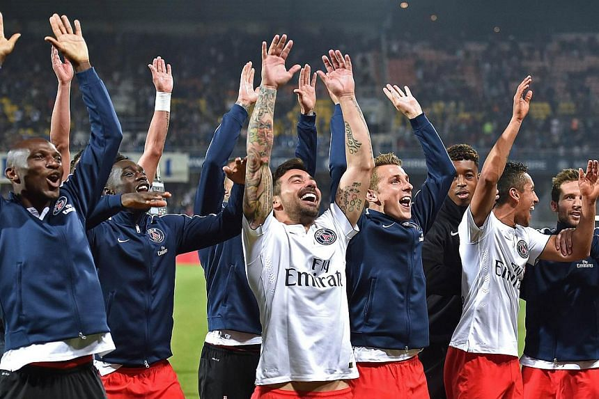 Paris Saint-Germain's players celebrate their 2-1 win at Montpellier on Saturday.PSG won their third consecutive French Championship title by winning the match. -- PHOTO: AFP