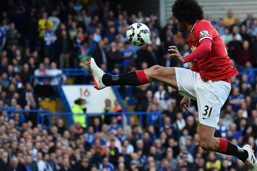 Manchester United's Belgian midfielder Marouane Fellaini jumps to control the ball during the English Premier League football match between Chelsea and Manchester United at Stamford Bridge in London on April 18, 2015. -- PHOTO: AFP