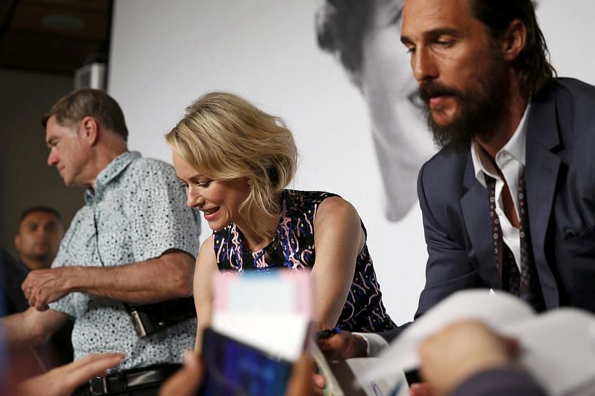 Cast members Naomi Watts (centre) and Matthew McConaughey (right), and director Gus Van Sant (left) sign autographs after a news conference for the film The Sea Of Trees at the 68th Cannes Film Festival on May 16, 2015. -- PHOTO: REUTERS