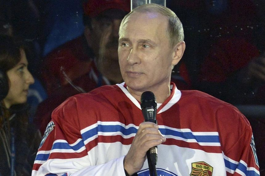 Russian President Vladimir Putin speaking during a gala match of the National Amateur Ice Hockey Teams' Festival organised by the Night Ice Hockey League in Sochi, Russia, on May 16, 2015. -- PHOTO: REUTERS
