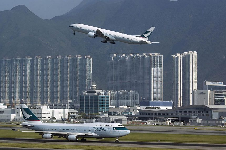 A Cathay Pacific Airways passenger plane takes off at the Hong Kong Airport in this Sept 11, 2013 file photo. The International Air Transport Association (Iata) said passenger terminals at several major airports in Asia, including those in Bangkok, H
